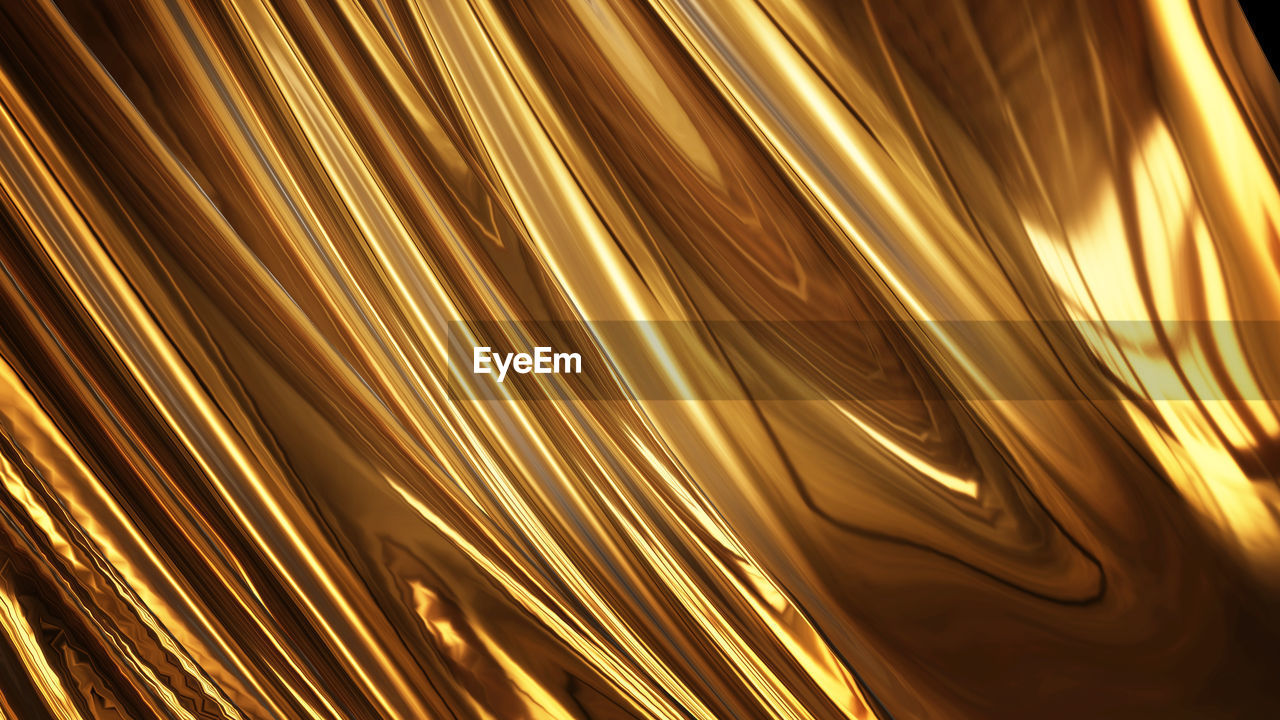 gold colored, full frame, backgrounds, pattern, no people, motion, abstract, close-up, illuminated, indoors, blurred motion, long exposure, glowing, yellow, metal, light - natural phenomenon, night, orange color, selective focus, lighting equipment