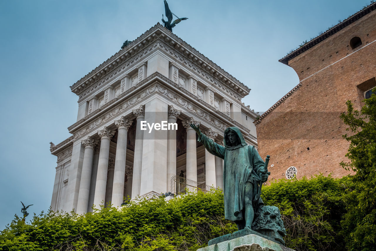 built structure, architecture, building exterior, sky, plant, low angle view, tree, nature, the past, history, sculpture, art and craft, representation, building, no people, day, statue, architectural column, travel destinations, human representation