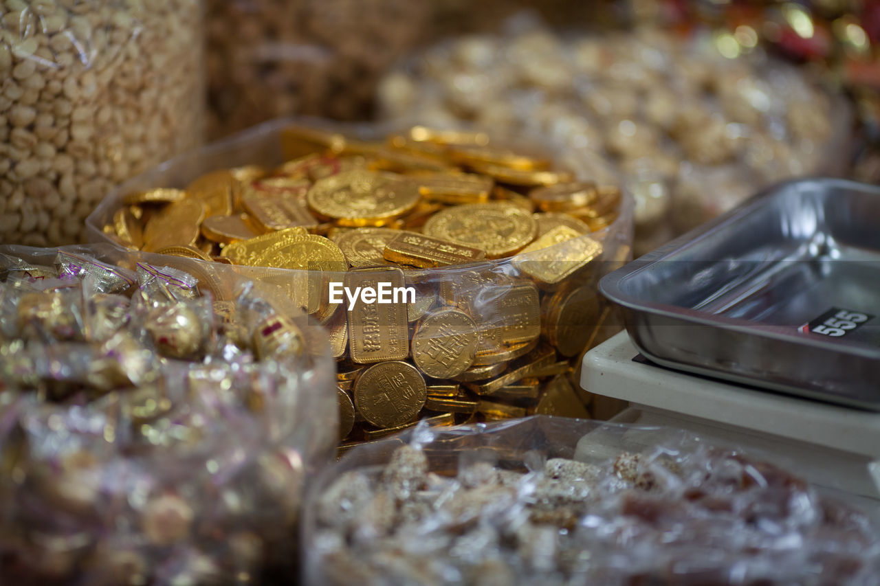 gold colored, gold, jewelry, wealth, large group of objects, for sale, collection, no people, indoors, retail, coin, close-up, luxury, ingot, day