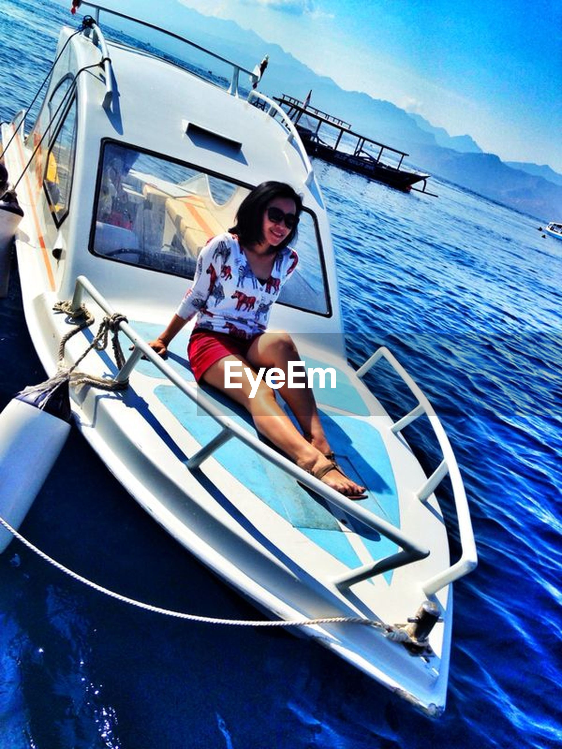 transportation, mode of transport, person, lifestyles, leisure activity, nautical vessel, young adult, sunglasses, boat, water, sitting, travel, portrait, looking at camera, casual clothing, front view, land vehicle, young men