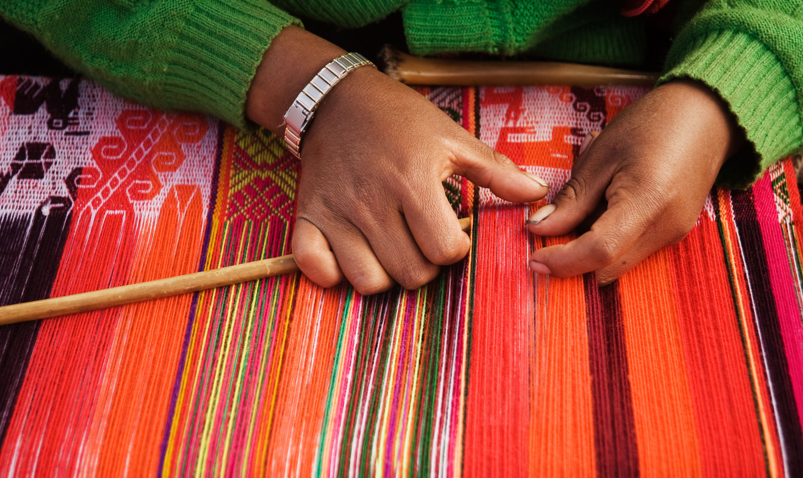 Midsection of woman working in traditional clothing