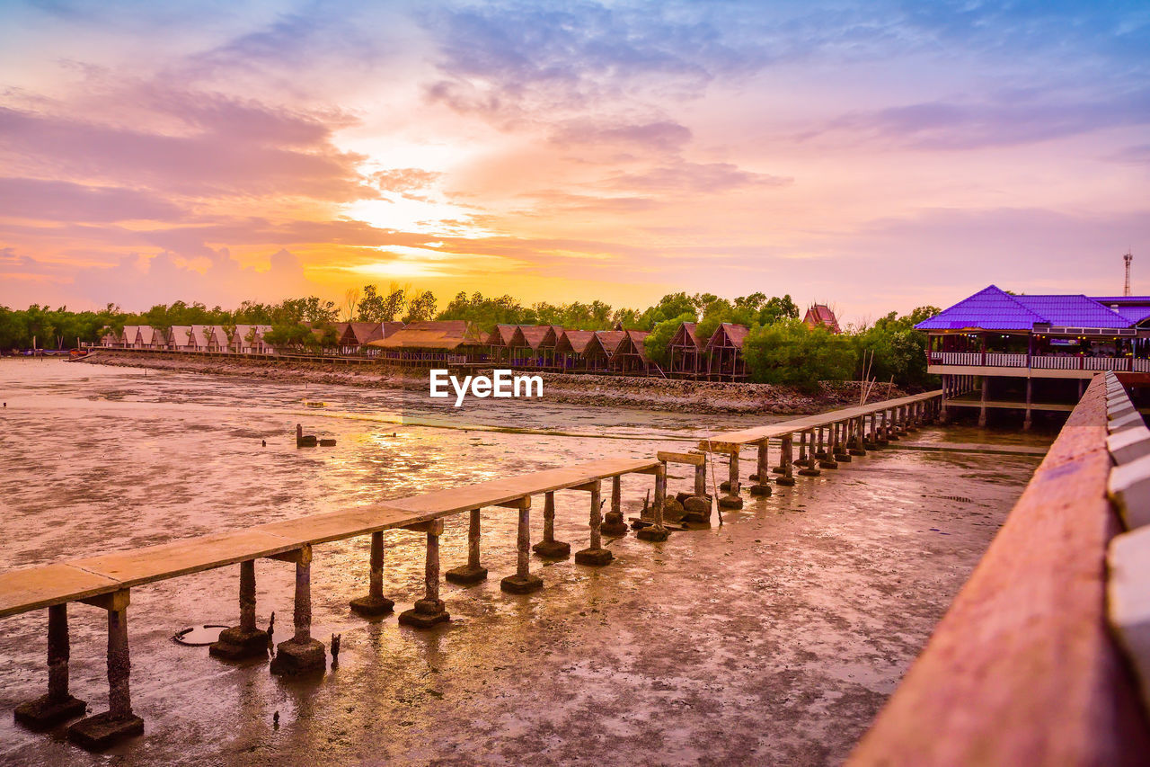 sky, sunset, cloud - sky, water, architecture, built structure, orange color, beauty in nature, nature, building exterior, scenics - nature, tree, tranquility, plant, building, no people, tranquil scene, river, outdoors