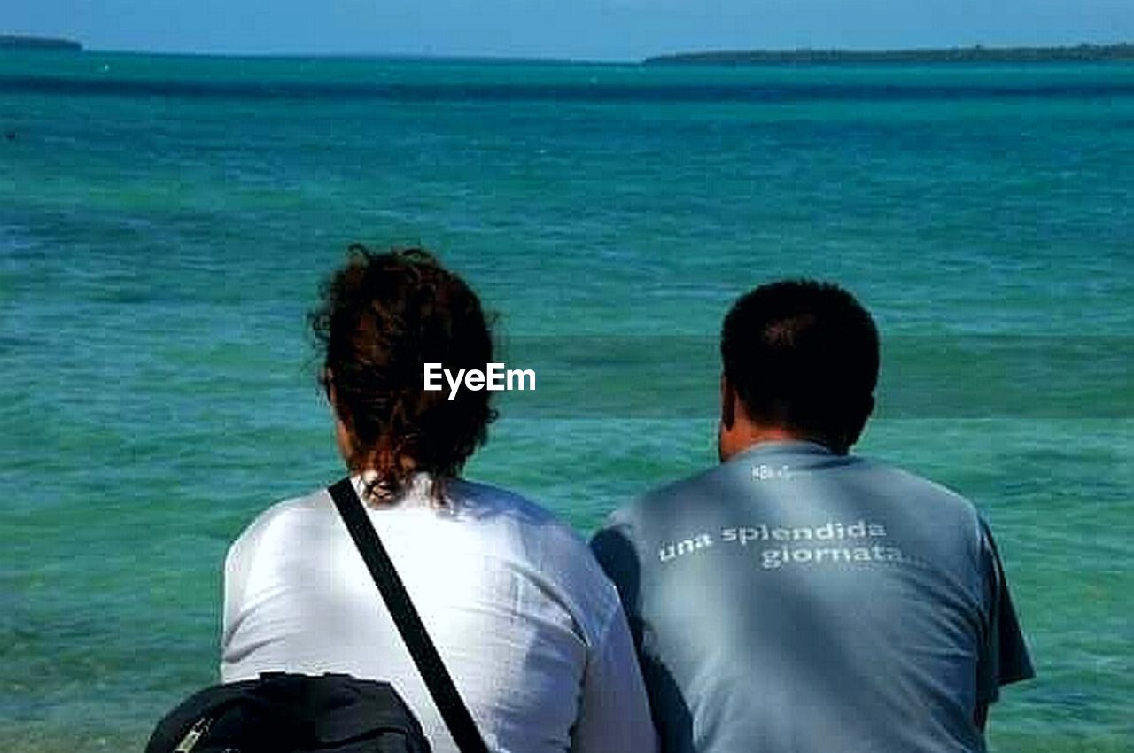 rear view, two people, sea, togetherness, men, adult, adults only, love, people, vacations, outdoors, day, women, water, friendship, back, only men, nature