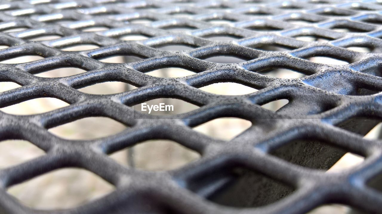 backgrounds, close-up, full frame, pattern, no people, metal, fence, selective focus, barrier, boundary, security, textured, protection, safety, design, shape, grid, repetition, focus on foreground, black color, silver colored, crisscross