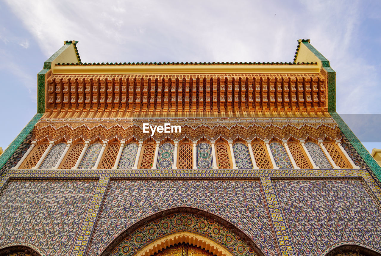 built structure, architecture, sky, low angle view, building exterior, pattern, building, no people, place of worship, roof, day, cloud - sky, religion, history, belief, nature, the past, arch, design, craft, ornate, roof tile