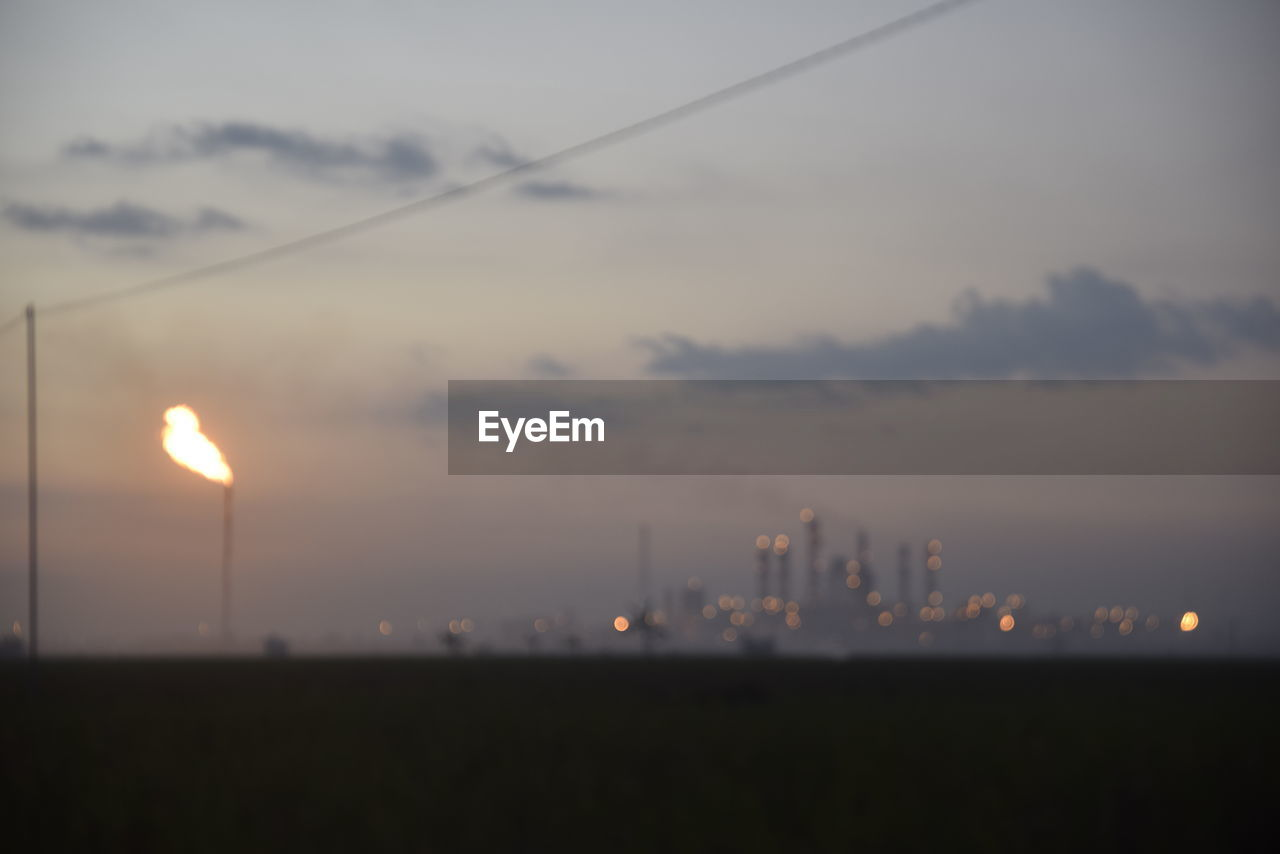 sunset, sky, no people, fuel and power generation, illuminated, nature, outdoors, electricity, sun, cloud - sky, beauty in nature, scenics, architecture, city, day, close-up