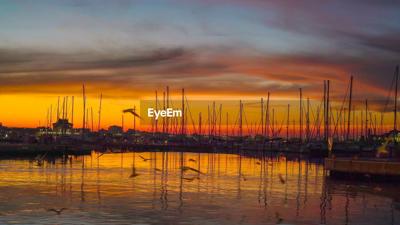 sunset, sky, cloud - sky, water, orange color, reflection, beauty in nature, scenics - nature, nature, no people, waterfront, tranquility, lake, silhouette, idyllic, tranquil scene, outdoors, harbor, nautical vessel, sailboat