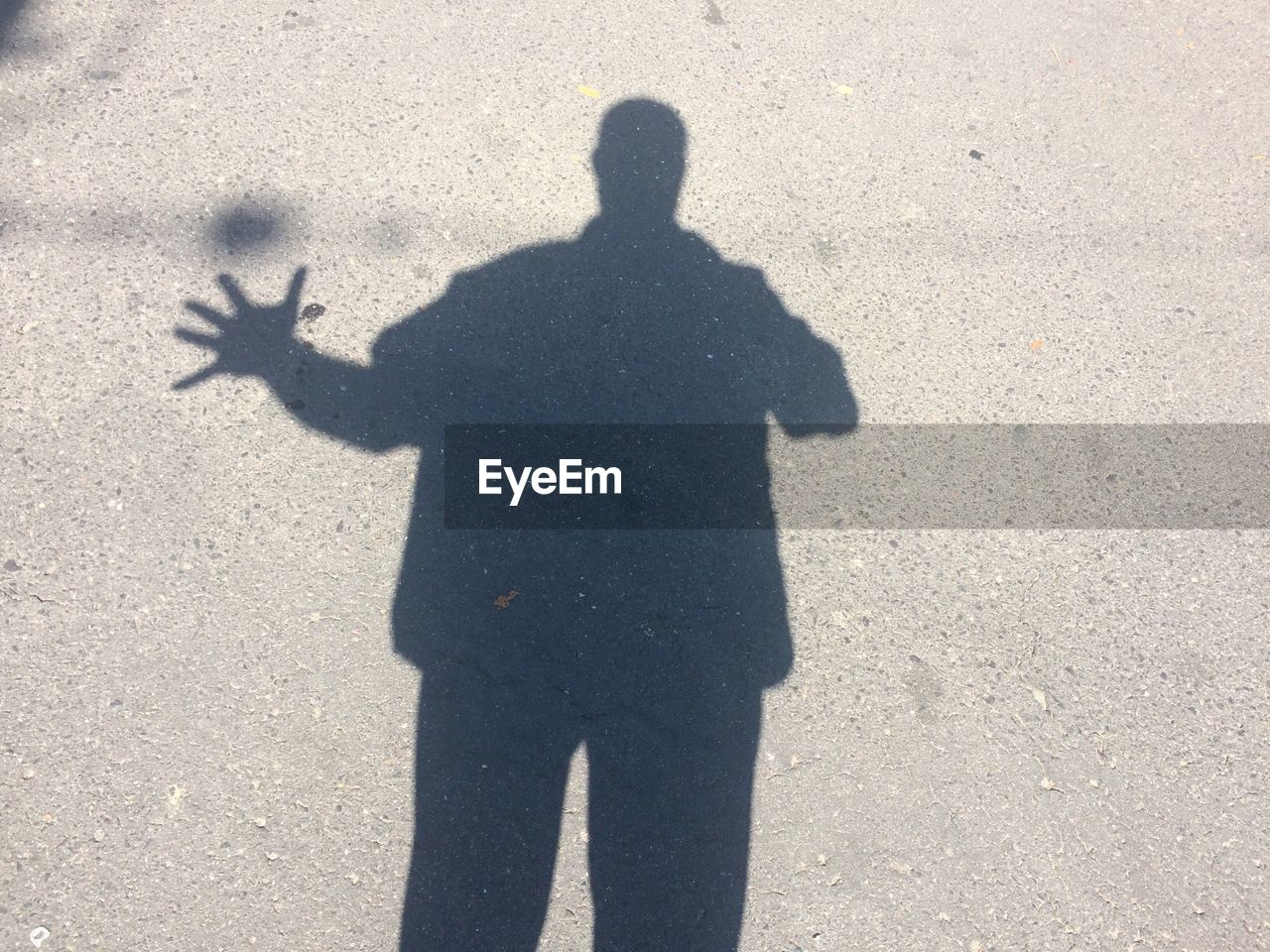 shadow, focus on shadow, sunlight, real people, silhouette, gesturing, men, outdoors, day, standing, one person