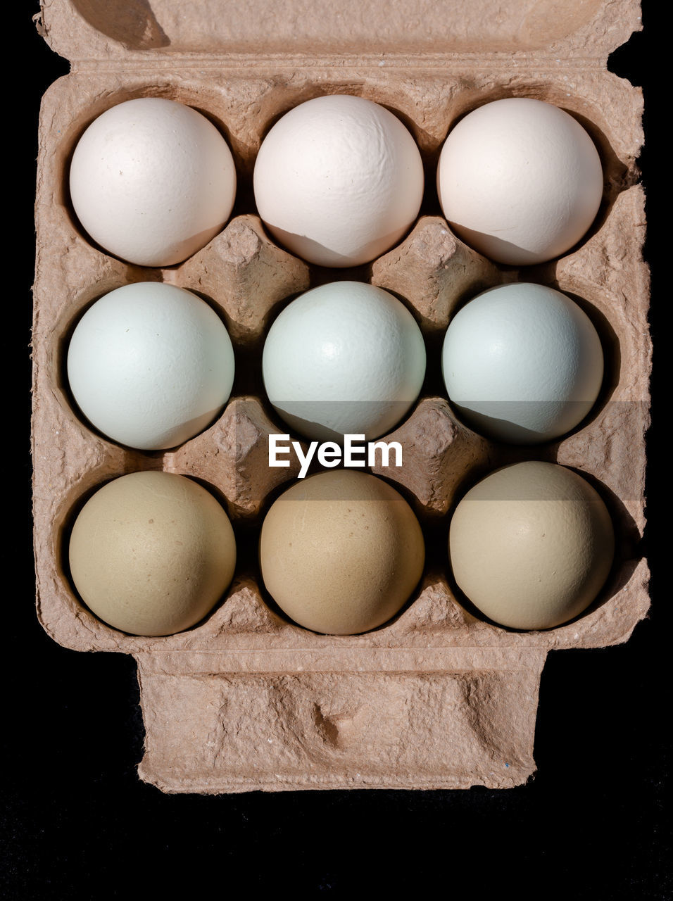 food and drink, food, egg, still life, wellbeing, freshness, healthy eating, indoors, directly above, arrangement, white color, high angle view, side by side, no people, container, egg carton, order, raw food, large group of objects, in a row, black background, tray