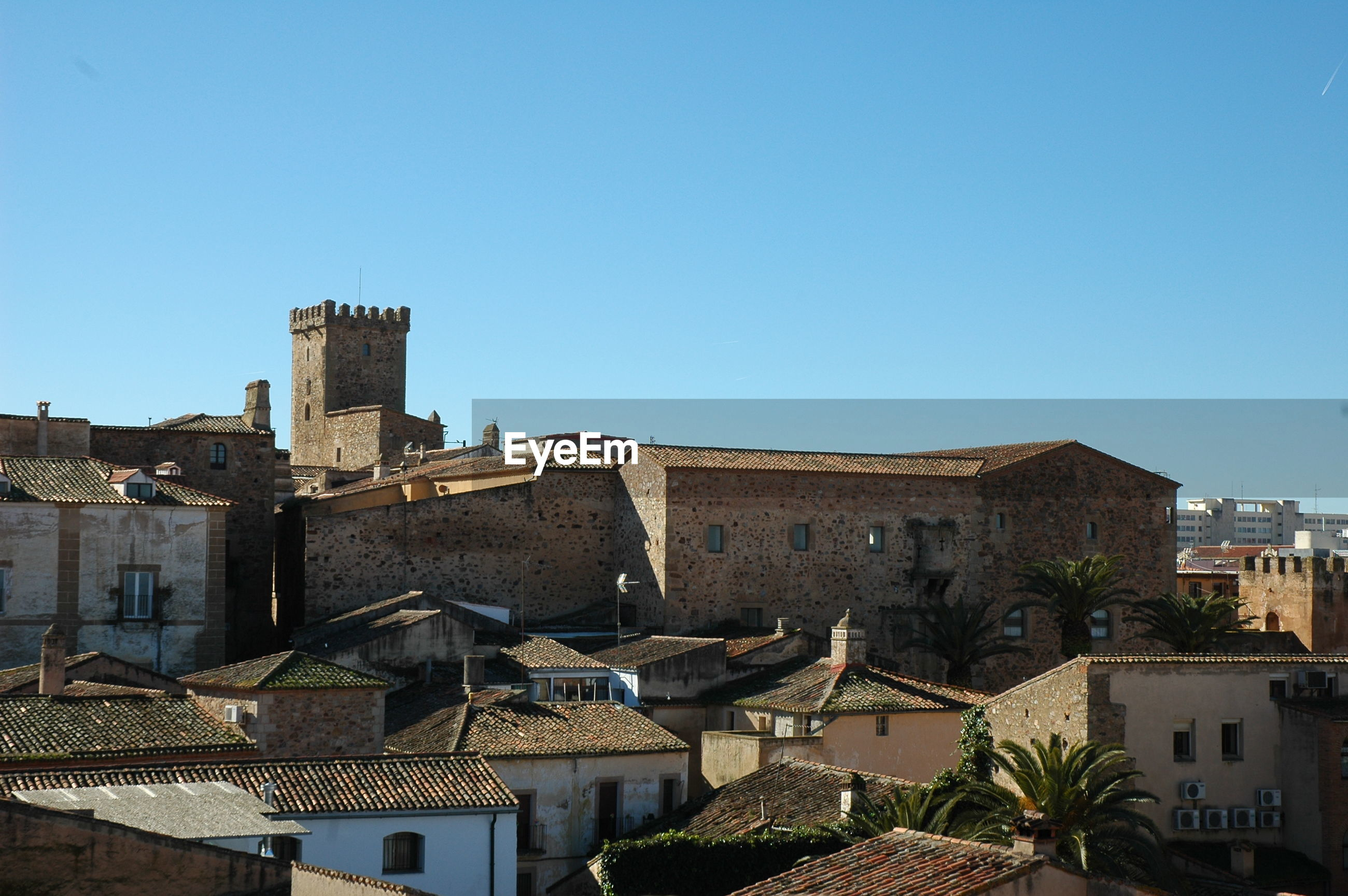 TOWNSCAPE AGAINST CLEAR BLUE SKY IN CITY