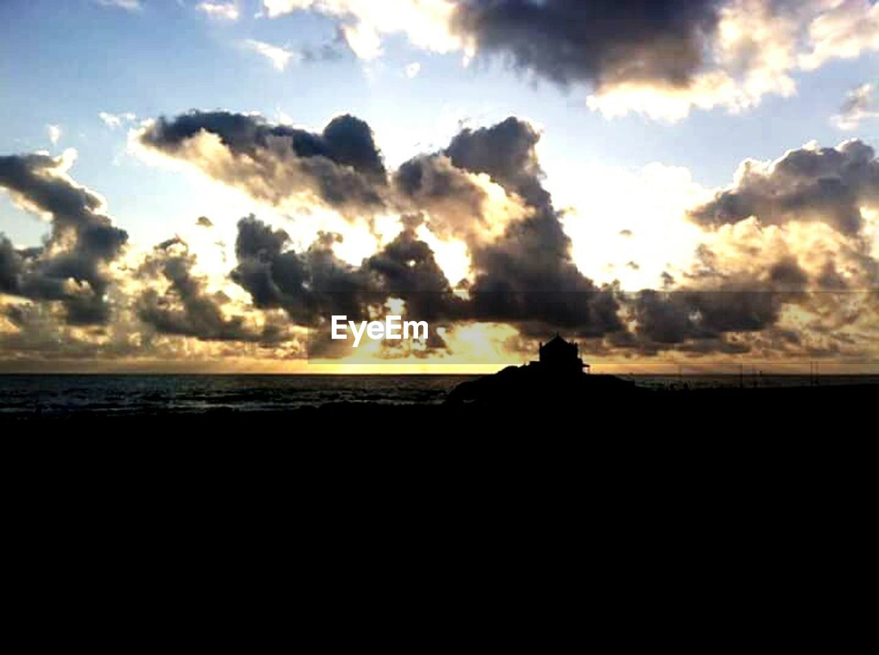 silhouette, sunset, sky, nature, scenics, beauty in nature, tranquility, sea, cloud - sky, no people, outdoors, day
