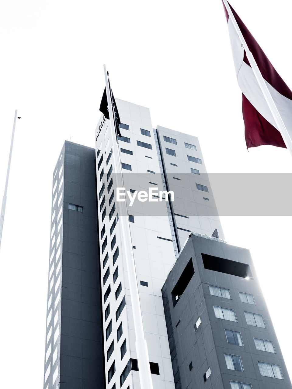 flag, patriotism, low angle view, building exterior, architecture, no people, built structure, day, outdoors, clear sky, city, sky
