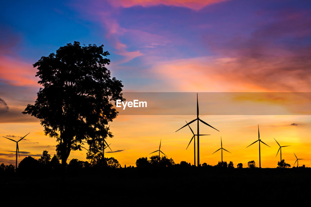 sunset, silhouette, sky, environmental conservation, renewable energy, alternative energy, fuel and power generation, orange color, environment, cloud - sky, beauty in nature, wind turbine, tree, turbine, plant, nature, wind power, scenics - nature, no people, technology, outdoors, sustainable resources, power supply, romantic sky