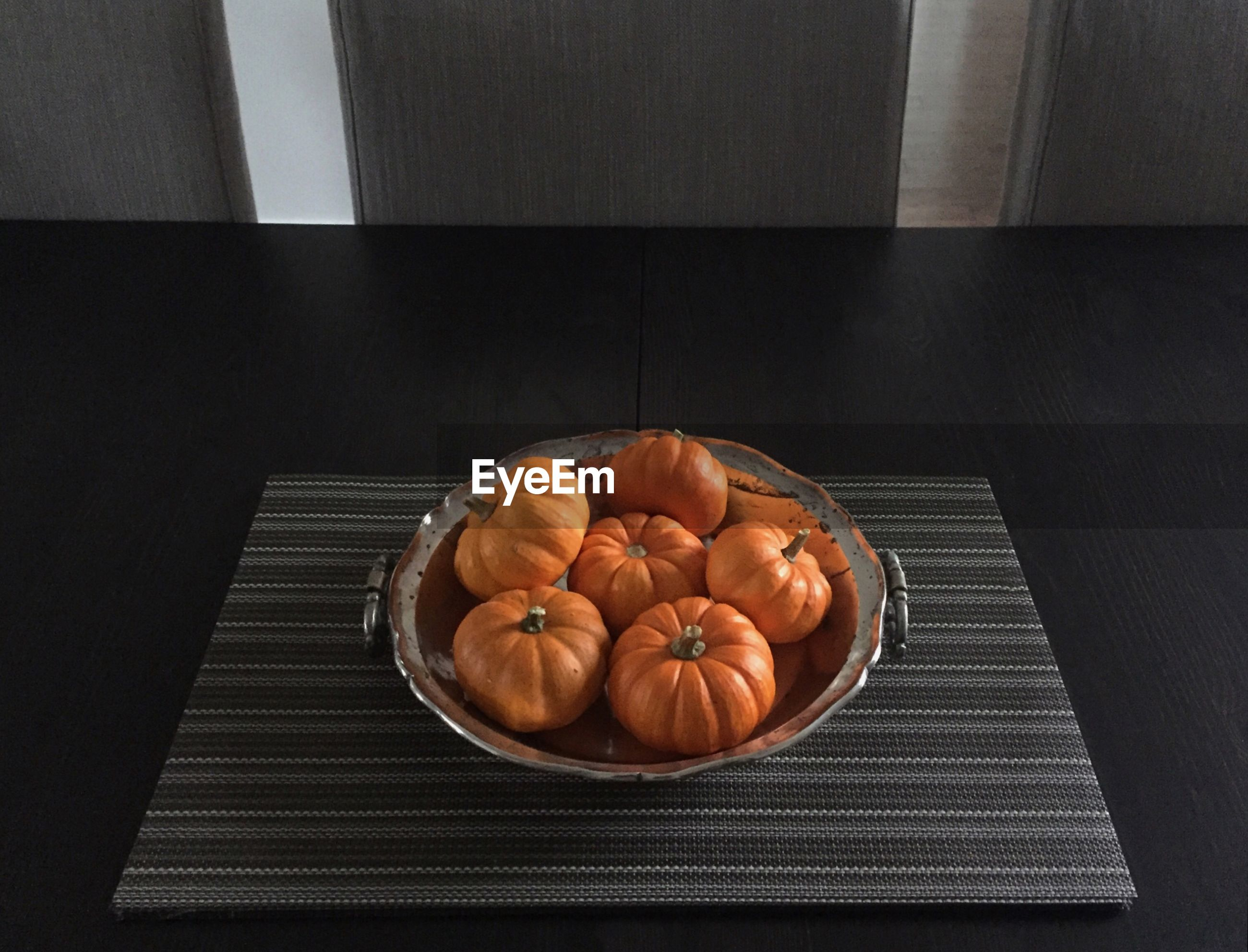 High angle view of pumpkins in container on table