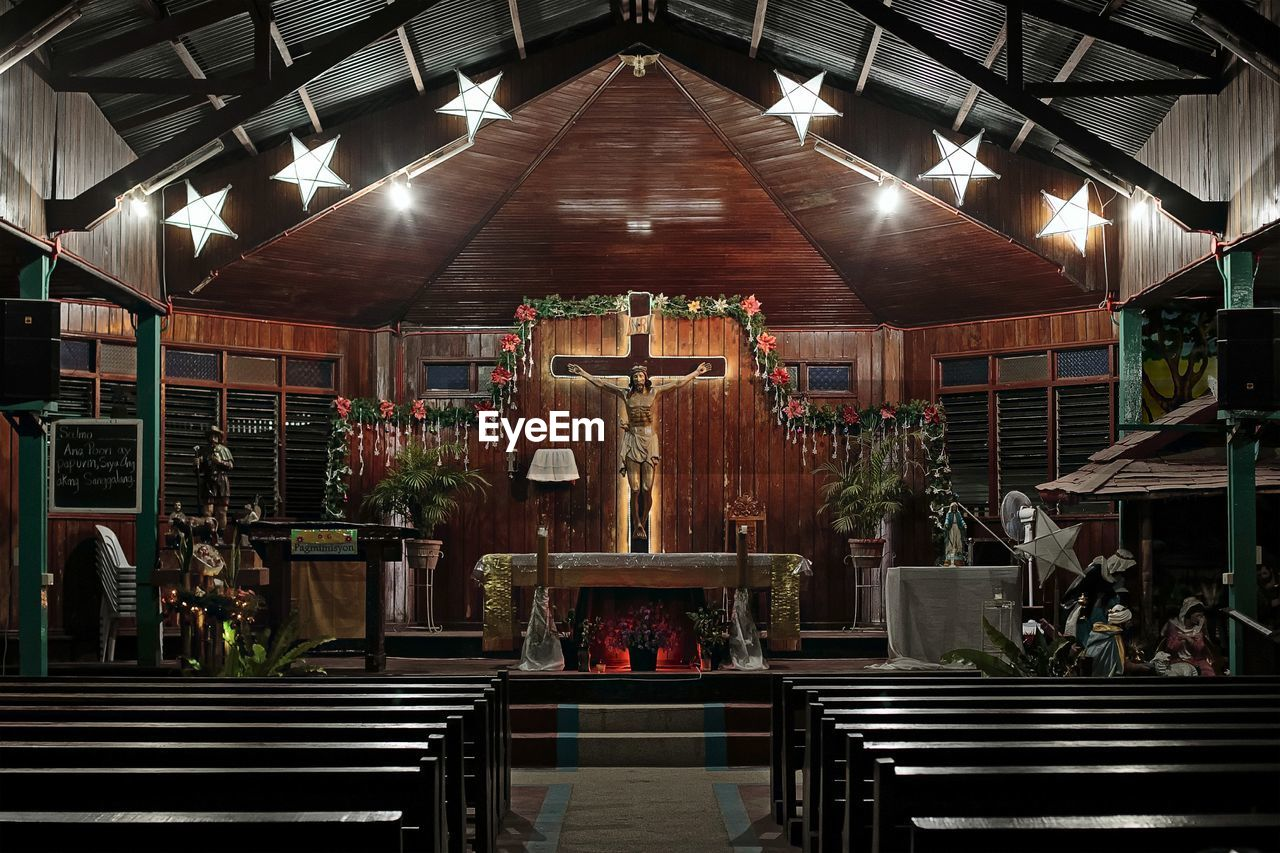 indoors, spirituality, illuminated, religion, place of worship, no people, pew, altar, statue, architecture, day