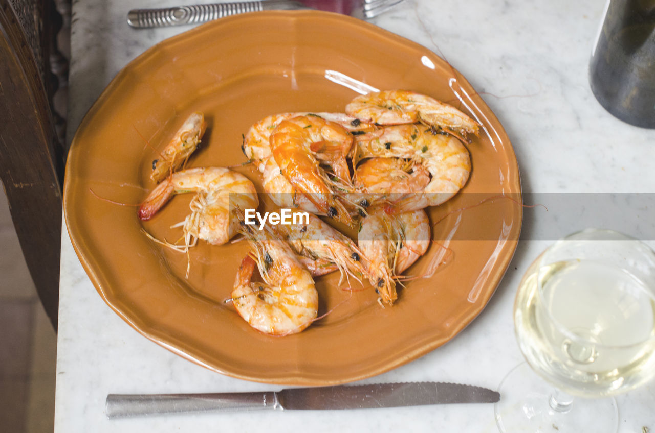 food and drink, food, freshness, high angle view, table, healthy eating, wellbeing, seafood, still life, indoors, ready-to-eat, no people, crustacean, close-up, kitchen utensil, bowl, shrimp - seafood, container, household equipment, eating utensil, glass