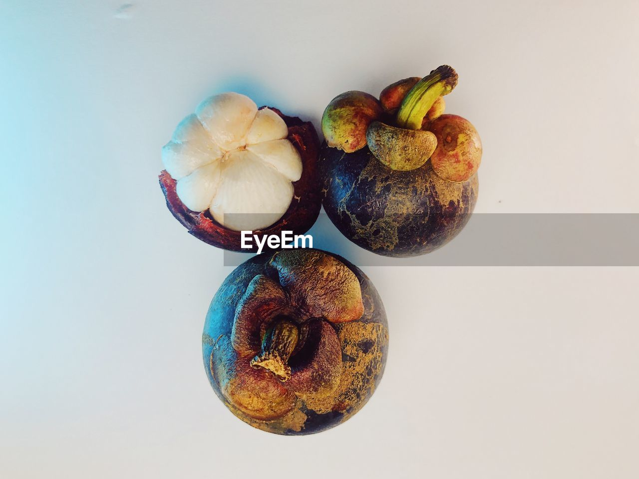 HIGH ANGLE VIEW OF FRUITS ON WHITE BACKGROUND