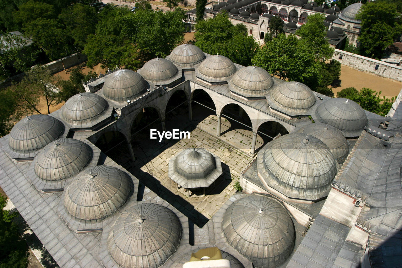 architecture, plant, built structure, no people, dome, day, building exterior, tree, nature, high angle view, outdoors, travel destinations, large group of objects, city, group of objects, religion, place of worship, building