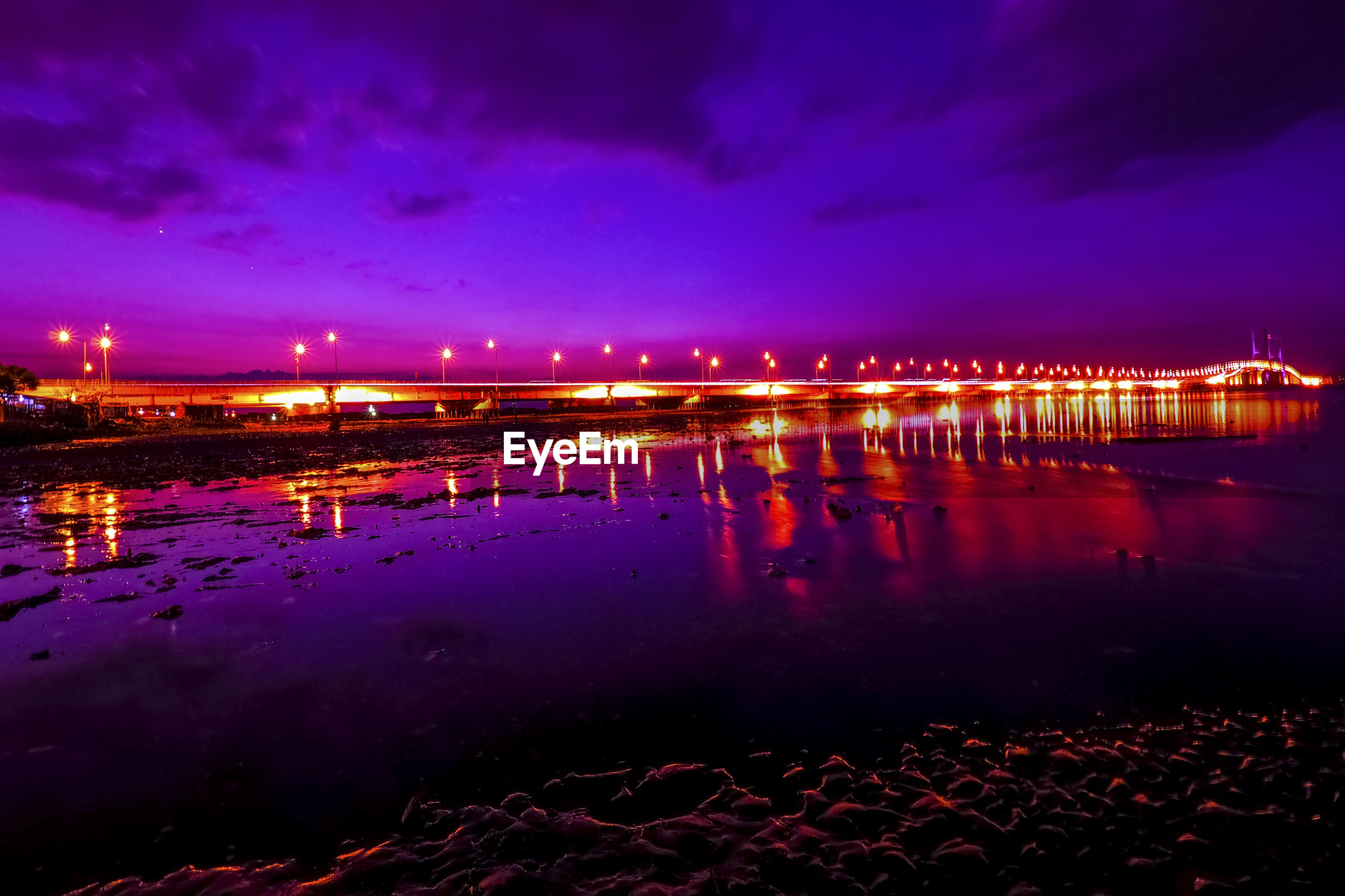 SCENIC VIEW OF ILLUMINATED LIGHTS AT NIGHT