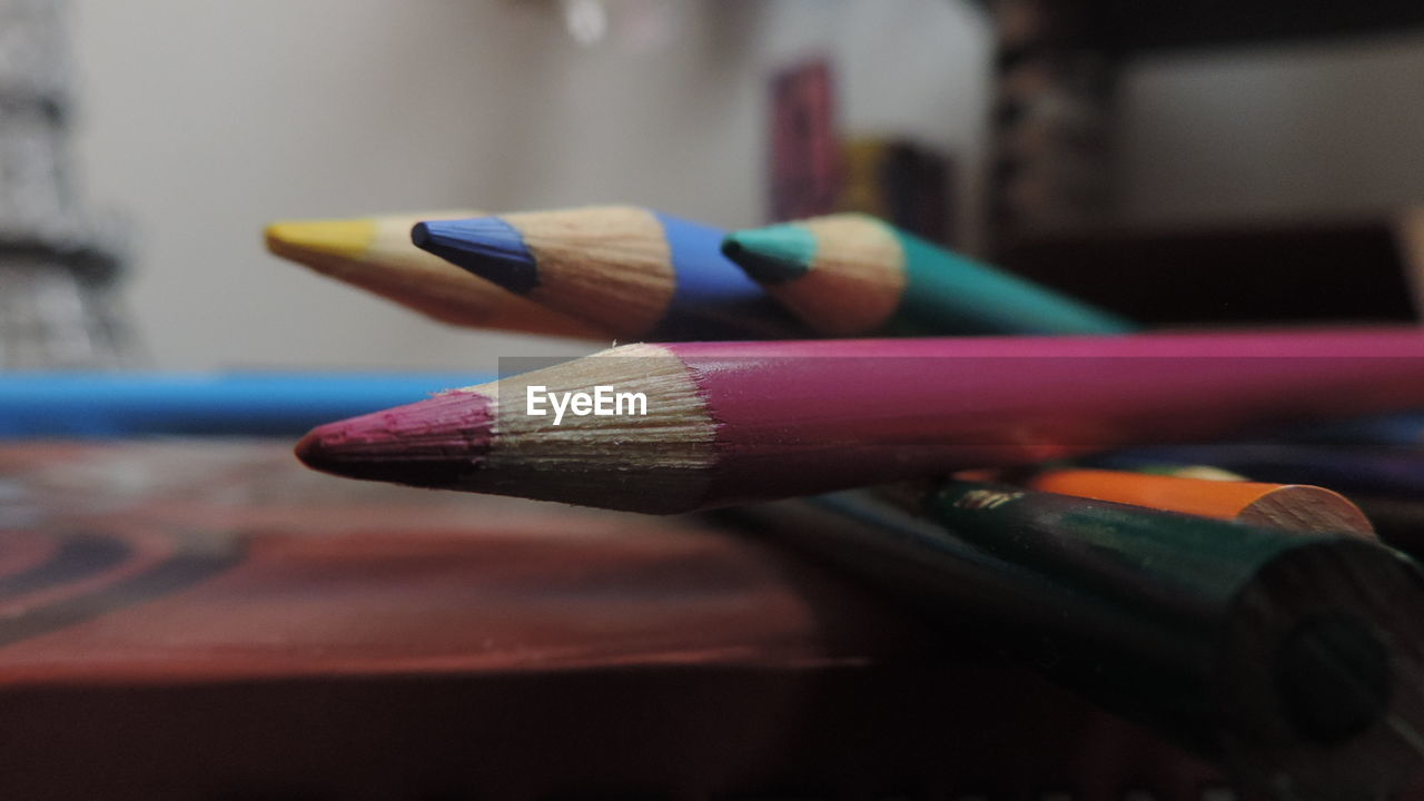 Close-Up Of Colored Pencil On Table