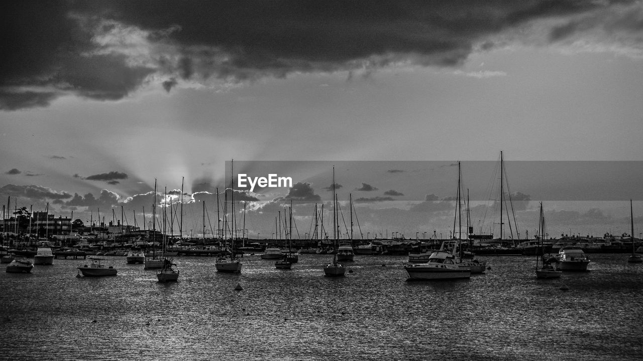 sky, nautical vessel, water, cloud - sky, transportation, boat, moored, mode of transport, harbor, no people, outdoors, mast, river, waterfront, day, nature, architecture, built structure, mountain, beauty in nature