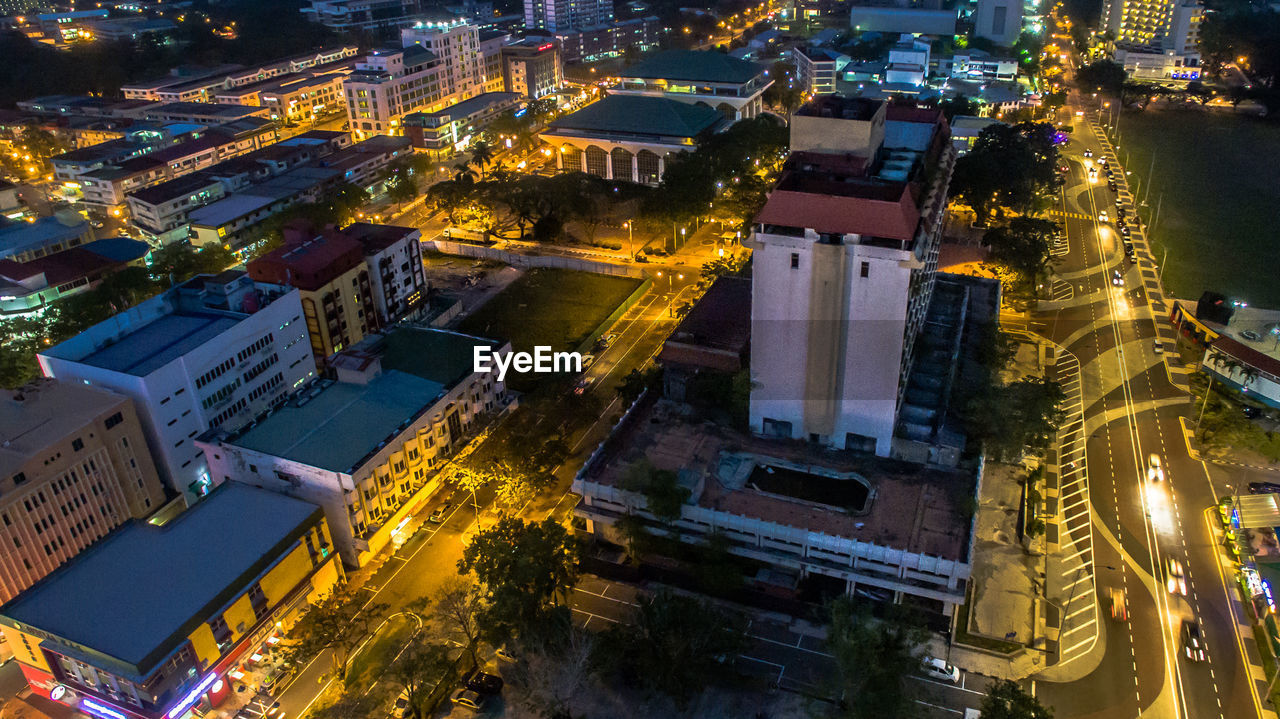 building exterior, city, architecture, night, built structure, illuminated, building, cityscape, high angle view, no people, city life, street, residential district, travel destinations, outdoors, road, glowing, transportation, nature, office building exterior, skyscraper, luxury