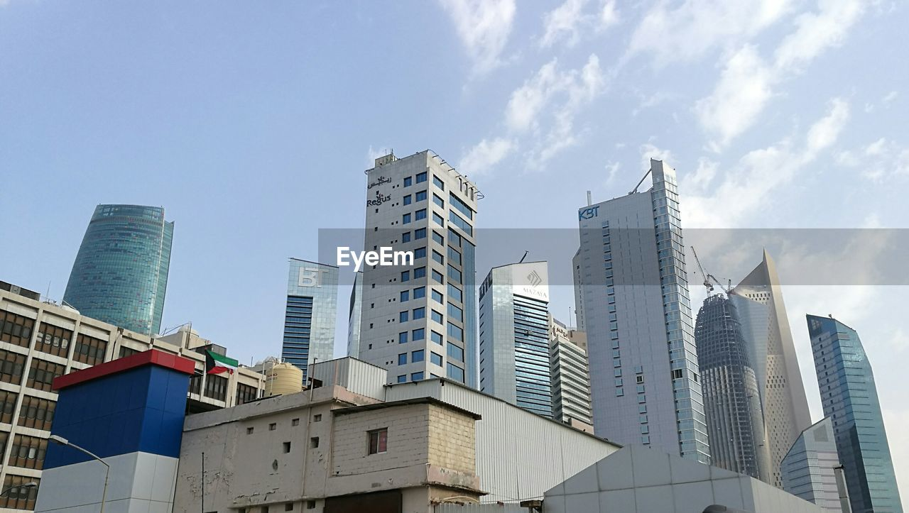 architecture, building exterior, low angle view, skyscraper, built structure, day, modern, sky, city, outdoors, no people