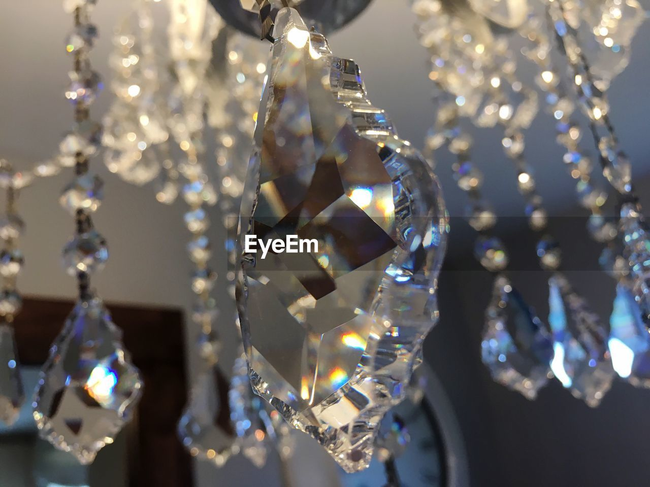 Low angle view of crystals hanging from chandelier