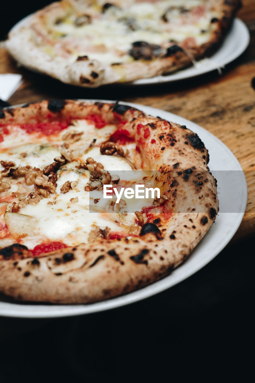 Close-up of pizza in plate on table