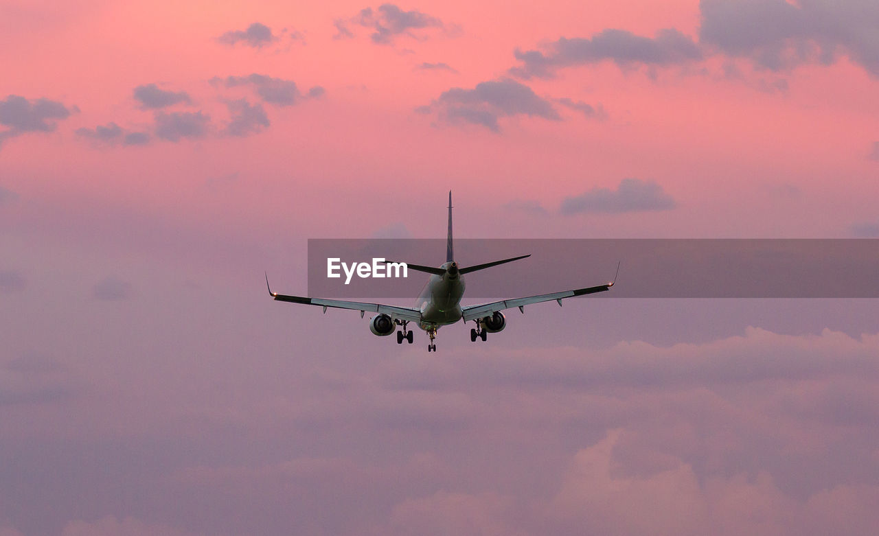 sunset, sky, air vehicle, mid-air, flying, cloud - sky, transportation, mode of transportation, airplane, low angle view, no people, motion, nature, orange color, on the move, travel, beauty in nature, outdoors, scenics - nature, journey