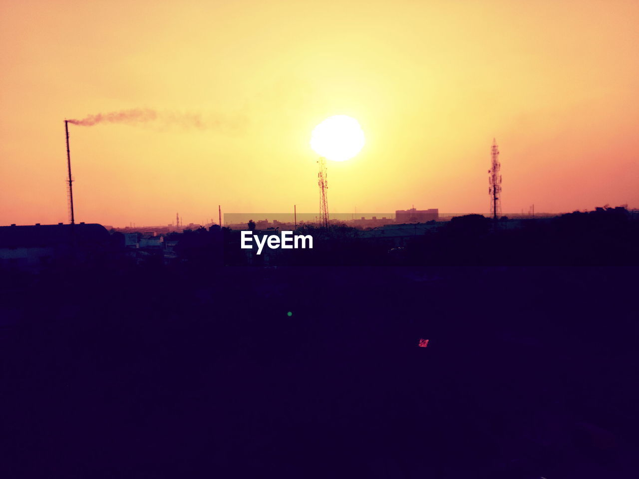 sunset, sun, silhouette, orange color, sky, built structure, no people, nature, fuel and power generation, architecture, technology, building exterior, outdoors, city, electricity pylon, electricity, beauty in nature, industry, illuminated, moon