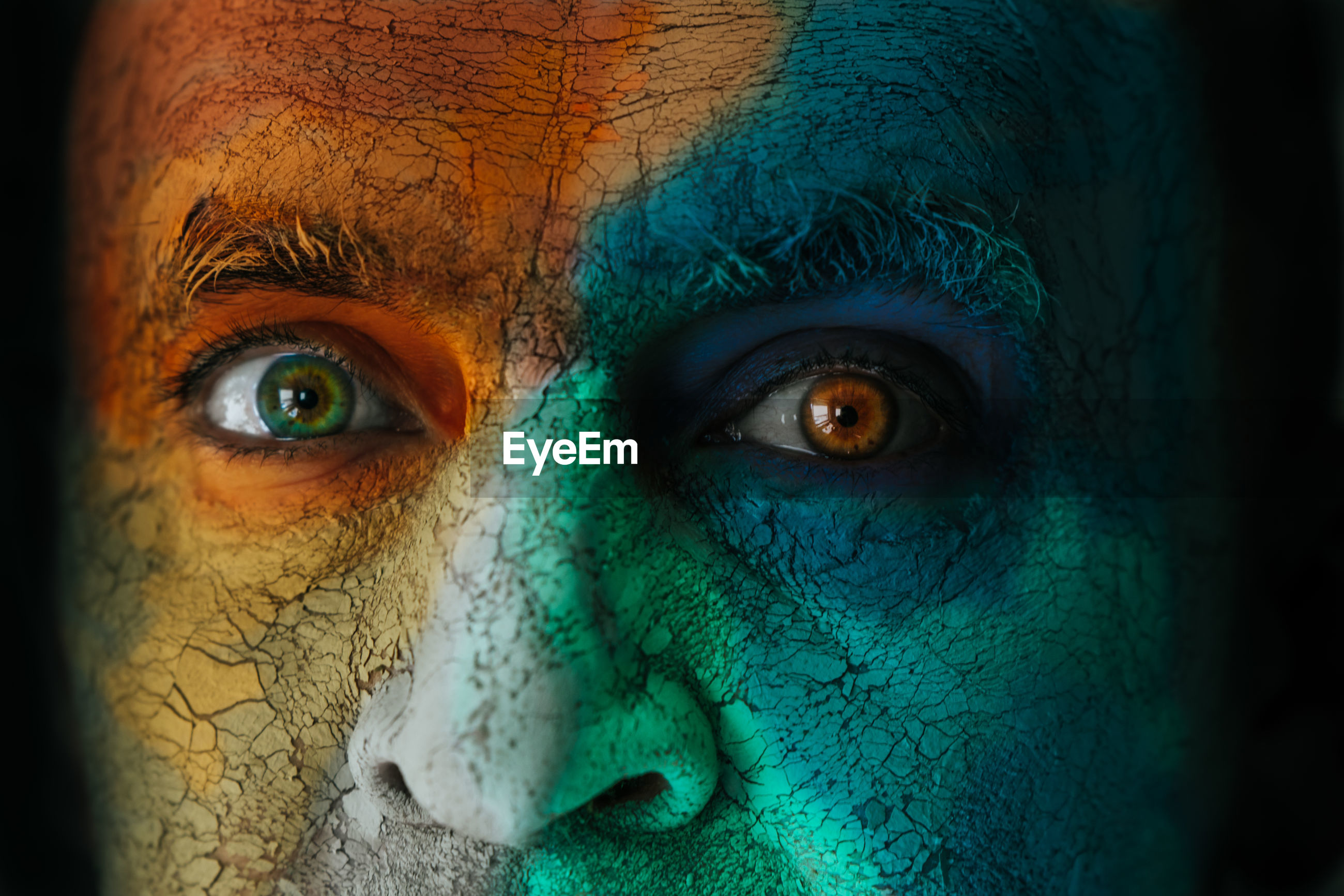 Close-up portrait of mature man with face paint