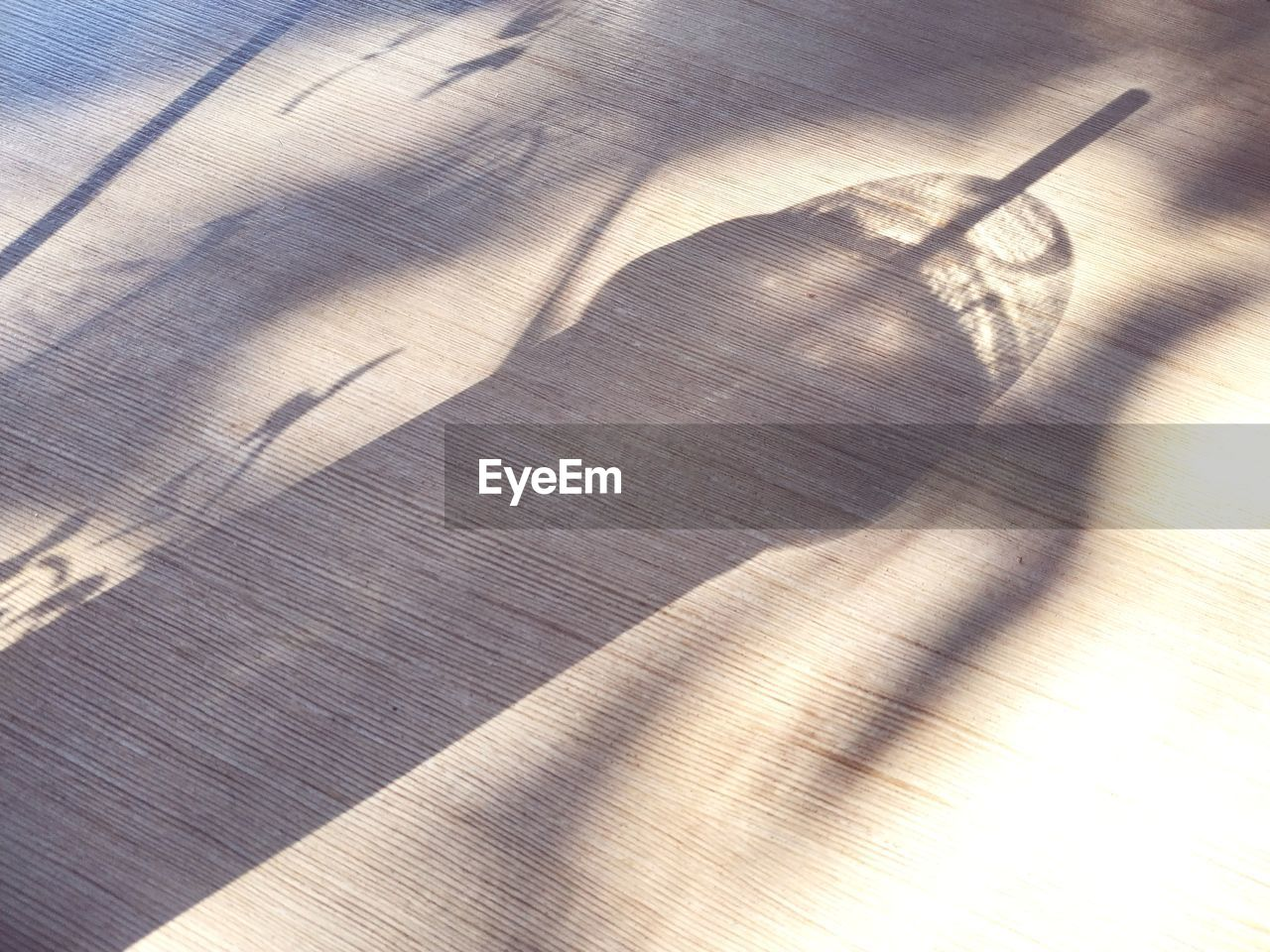 shadow, sunlight, high angle view, no people, wood - material, hardwood floor, close-up, textured, wood, nature, table, day, backgrounds, indoors, flooring, pattern, full frame, single object, textile, wood grain, focus on shadow