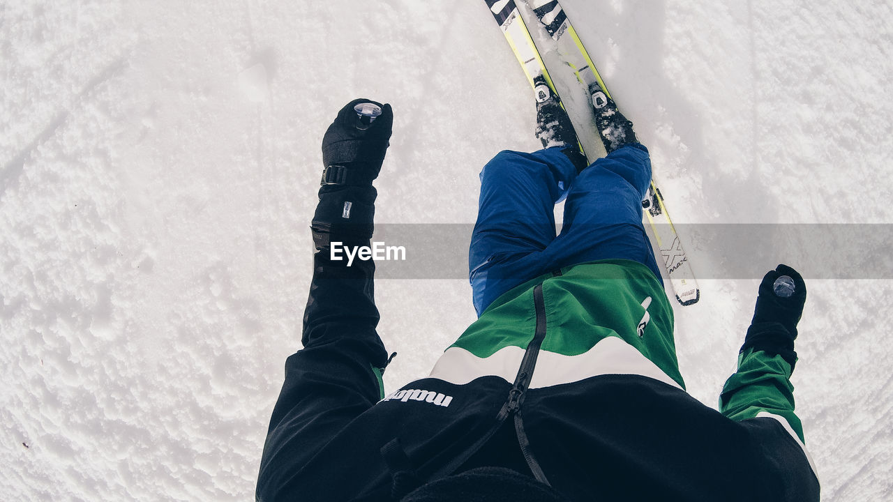 low section, real people, human leg, winter, snow, one person, cold temperature, lifestyles, shoe, body part, leisure activity, day, human body part, nature, sport, personal perspective, unrecognizable person, men, outdoors, human foot, warm clothing