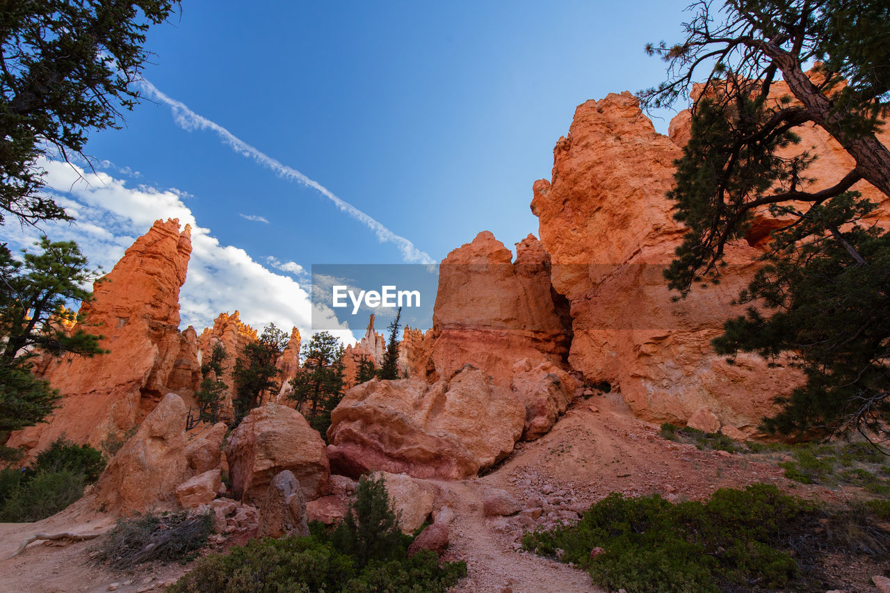 sky, rock, rock - object, tranquil scene, rock formation, beauty in nature, scenics - nature, nature, solid, tree, plant, tranquility, non-urban scene, physical geography, no people, geology, cloud - sky, mountain, day, remote, eroded, formation, arid climate