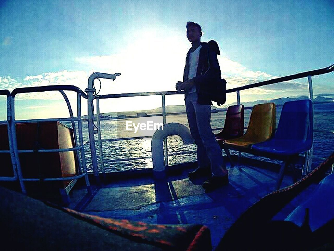 transportation, one person, men, sea, mode of transport, sky, nautical vessel, one man only, full length, water, standing, day, real people, outdoors, only men, adult, boat deck, nature, adults only, people, young adult