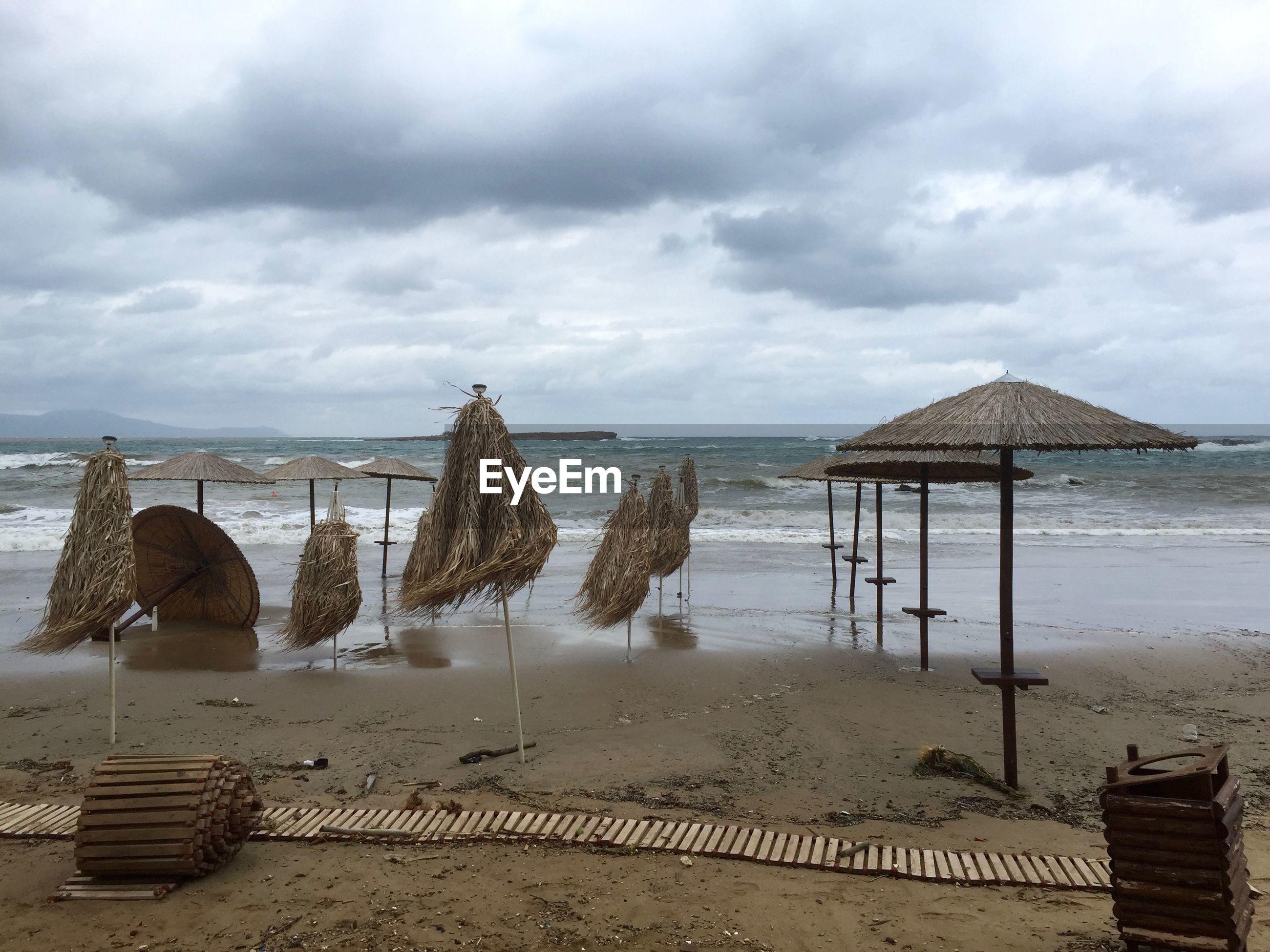 GAZEBO ON BEACH AGAINST SKY