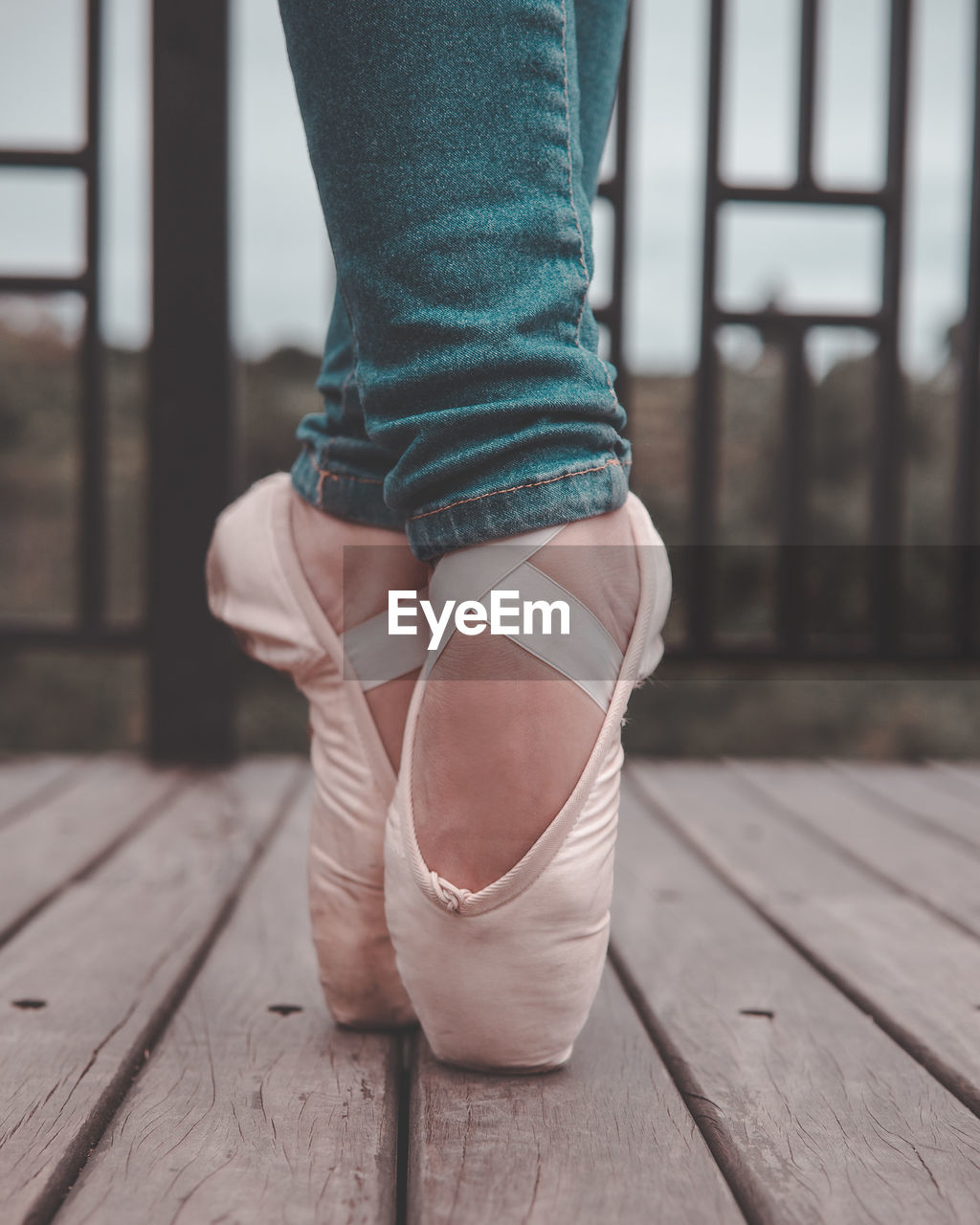 one person, real people, low section, wood - material, indoors, flooring, focus on foreground, human body part, human leg, wood, body part, shoe, lifestyles, dancing, hardwood floor, standing, ballet, ballet dancer, women, human limb, human foot
