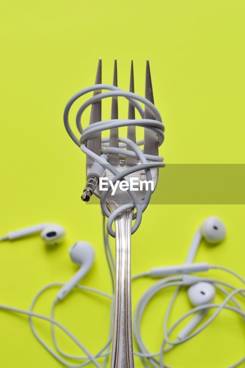 metal, connection, yellow, no people, technology, colored background, studio shot, cable, indoors, close-up, green color, creativity, representation, still life, electricity, silver colored, equipment, animal representation, bicycle, tangled