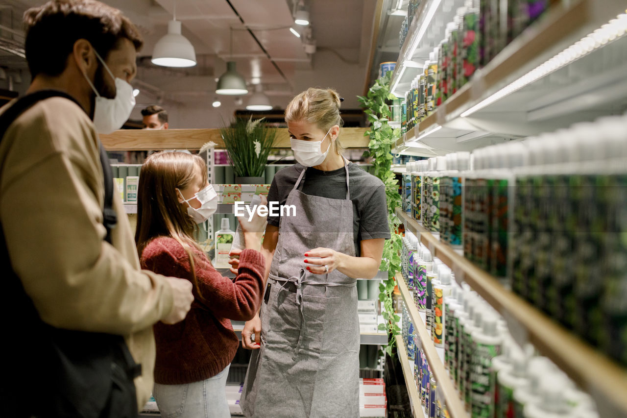 PEOPLE STANDING IN STORE