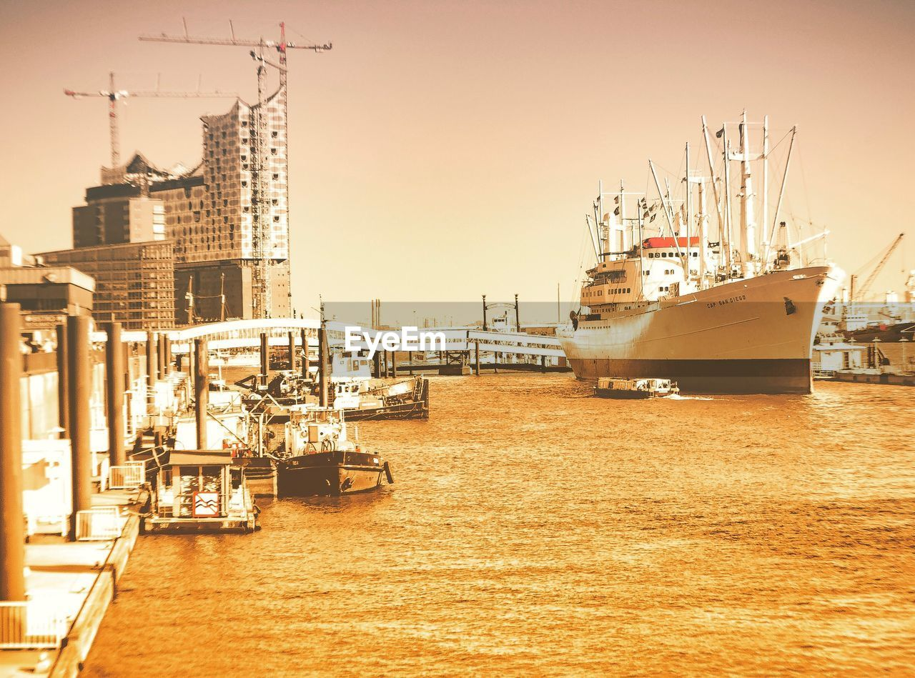 nautical vessel, transportation, water, harbor, architecture, mode of transport, moored, built structure, building exterior, no people, outdoors, sea, commercial dock, day, sky