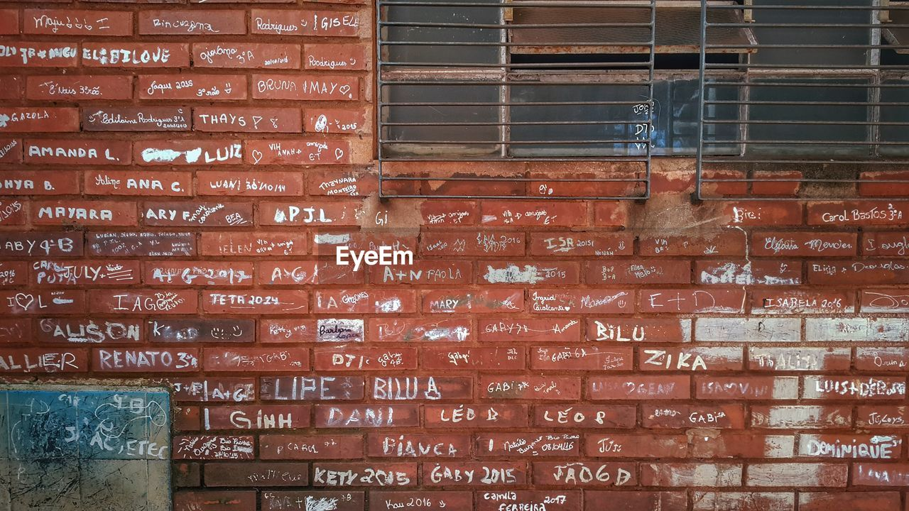brick wall, text, no people, day, backgrounds, architecture, built structure, outdoors, full frame, building exterior, red, close-up