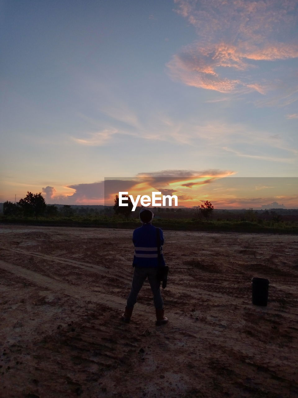 sky, sunset, one person, rear view, cloud - sky, real people, full length, nature, scenics - nature, beauty in nature, land, leisure activity, lifestyles, standing, field, men, tranquil scene, tranquility, environment, outdoors