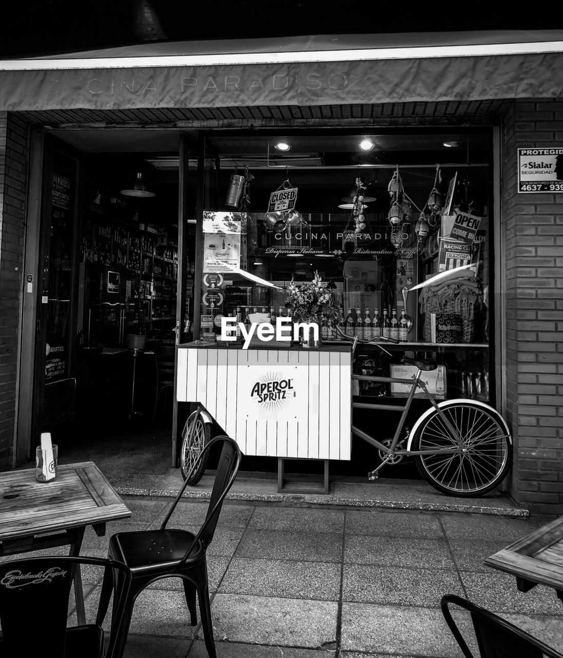 seat, architecture, text, chair, restaurant, cafe, built structure, business, building exterior, table, western script, communication, food and drink, no people, city, night, store, sign, outdoors