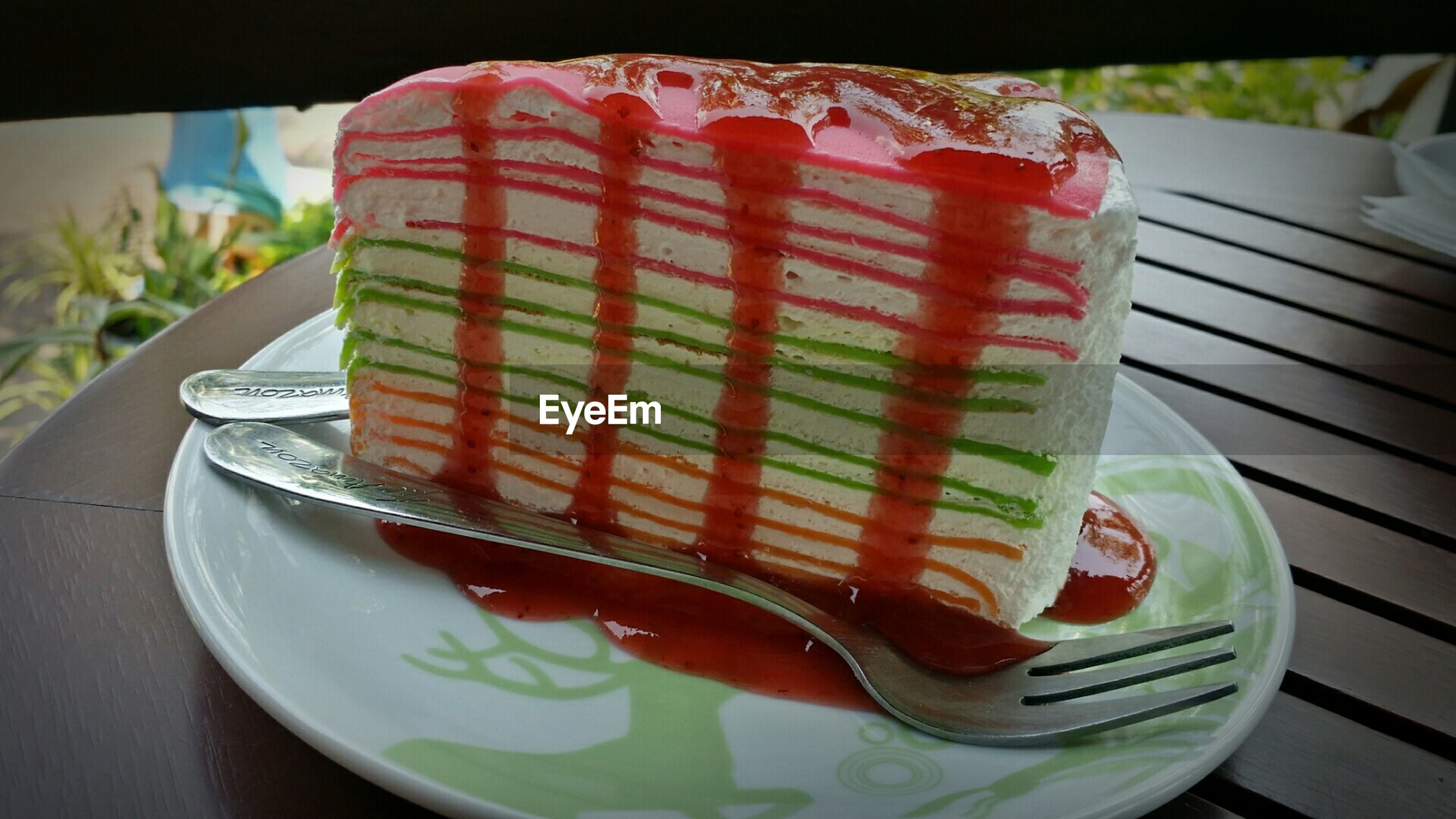 Close-up of crepe cake slice on table