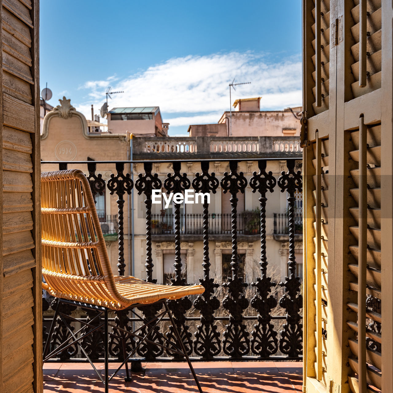 Buildings seen through balcony