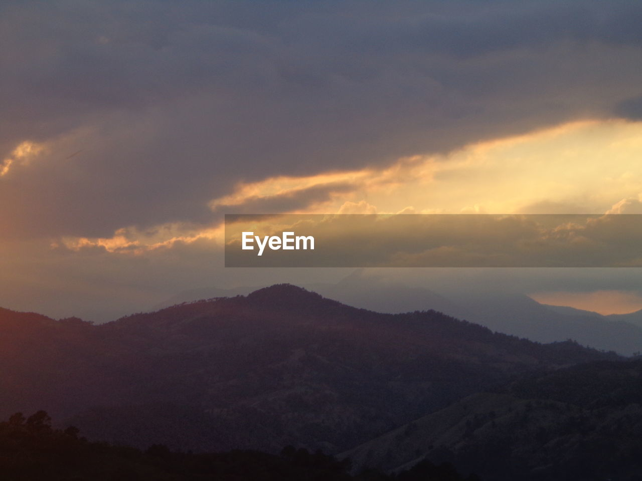 tranquil scene, beauty in nature, nature, tranquility, scenics, mountain, sunset, sky, idyllic, no people, outdoors, cloud - sky, silhouette, landscape, mountain range, day