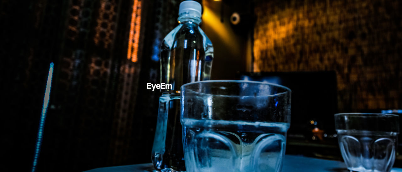 drink, refreshment, food and drink, glass, indoors, household equipment, transparent, drinking glass, alcohol, glass - material, no people, still life, close-up, focus on foreground, freshness, motion, table, water, restaurant, bar counter