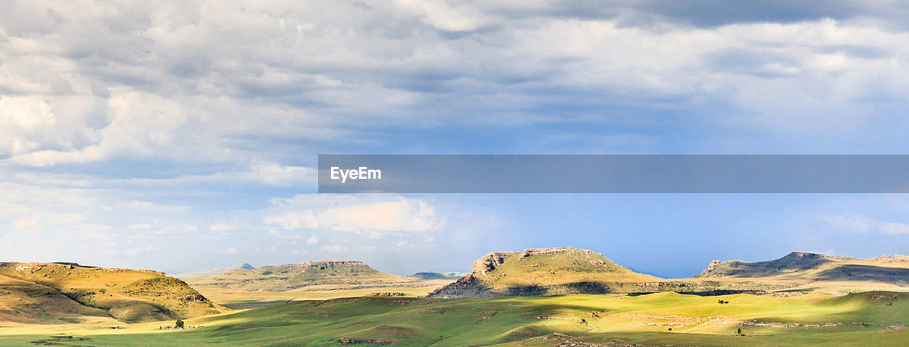 scenics - nature, cloud - sky, landscape, environment, sky, rock, land, nature, beauty in nature, rock - object, solid, mountain, no people, tranquil scene, non-urban scene, day, tranquility, mountain range, travel destinations, rock formation, outdoors, semi-arid, arid climate, climate