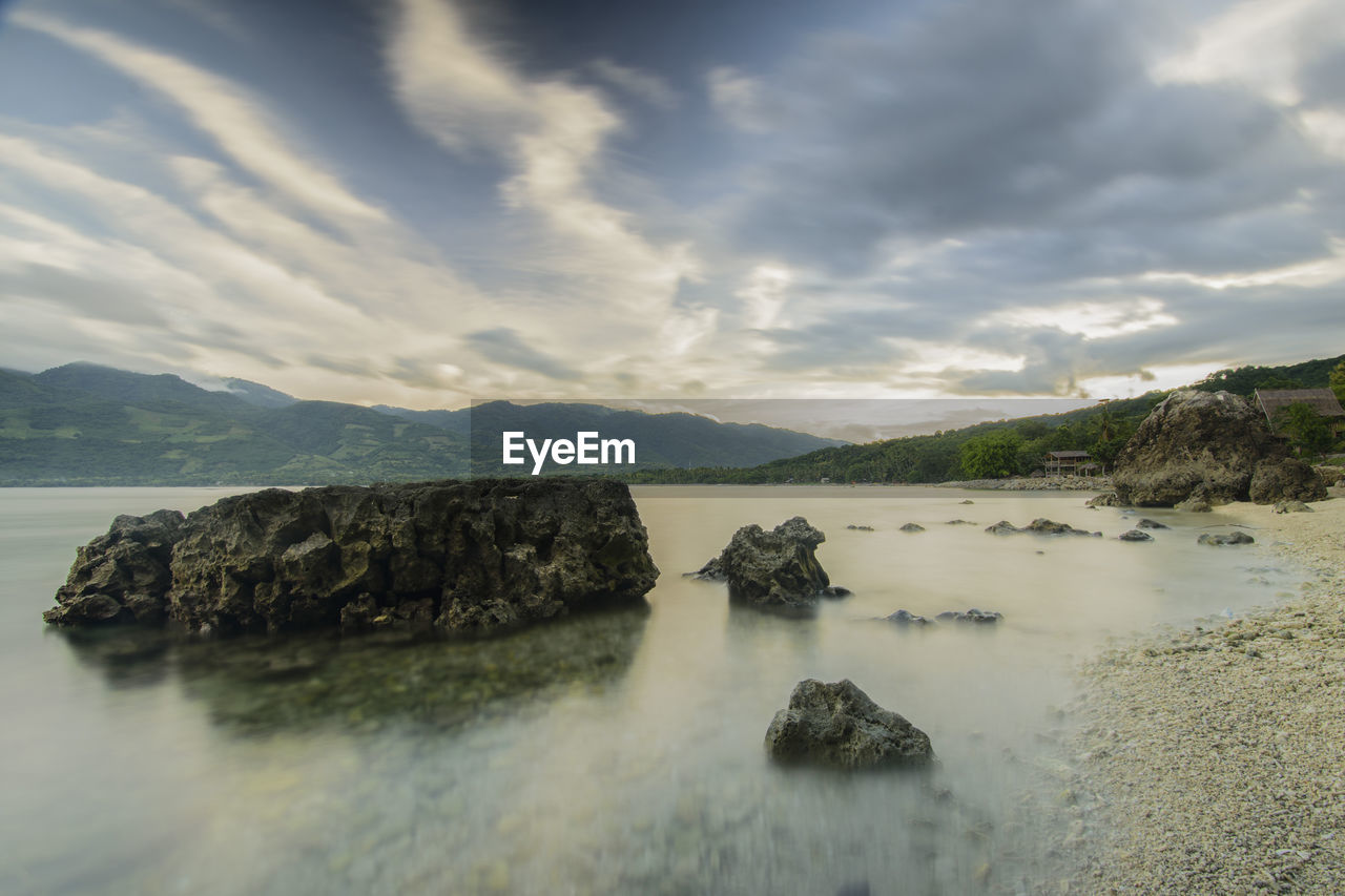 cloud - sky, sky, water, beauty in nature, scenics - nature, tranquil scene, tranquility, rock, no people, nature, rock - object, solid, sea, day, mountain, land, outdoors, non-urban scene, idyllic
